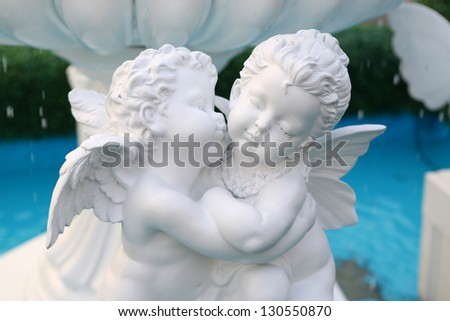 Statue of Cupid at public fountain in thailand - stock photo