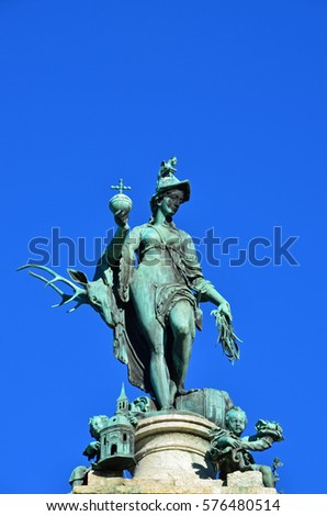 Statue of Diana in Munich under blue sky and sunshine