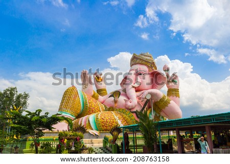 statue of ganesha under cloud sky in Thailand temple - stock photo
