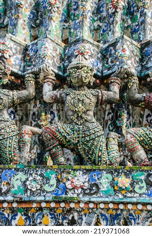 Statue of Giant at Wat Arun. Wat Arun or Temple of the Dawn is one of a famous Buddhist temple in Bangkok, Thailand. - stock photo