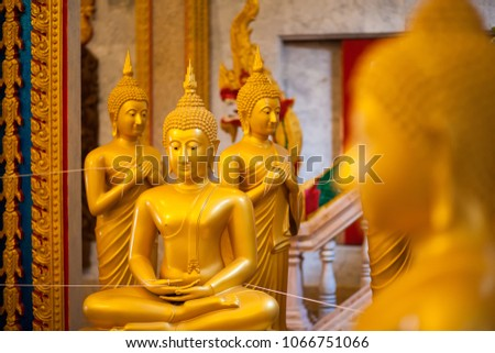 stock-photo-statue-of-golden-buddha-in-w