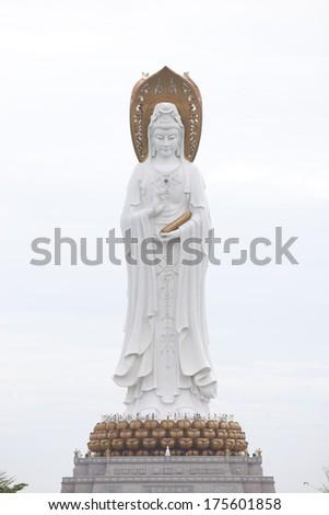 Statue of Guan Yin (goddess of mercy) , Buddhism symbol in China,located in Sanya city,china - stock photo