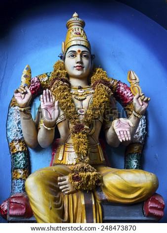 Statue of Hindu god inside Batu Caves in Kuala Lumpur, Malaysia. - stock photo