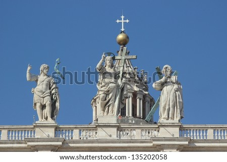 Statue of Jesus christ an saint john the baptist on the top of the facade of Saint Peter in Rome - stock photo