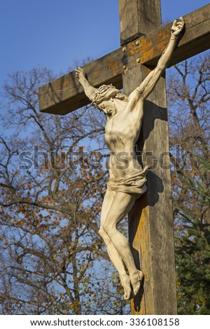Statue of Jesus Christ on the cross - the crucifix - stock photo