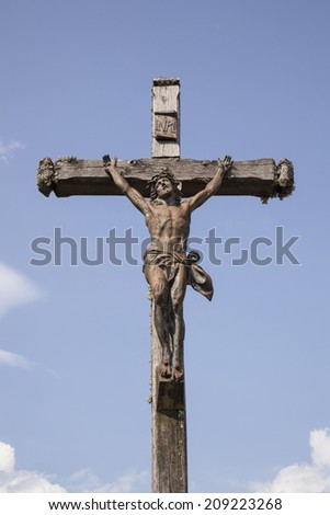 statue of Jesus on the cross in the french region Jura - stock photo
