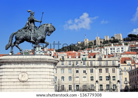 Statue of Joao I, with Sao Jorge castle in the background in Praca da Figueira, Lisbon Portugal