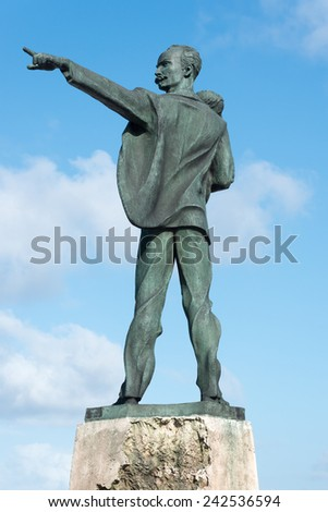 Statue of Jose Marti carrying a child facing the US Interests Section in Havana - stock photo