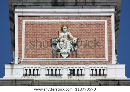 Statue of Justice Goddess in the Bell Tower of Venice, Italy - stock photo
