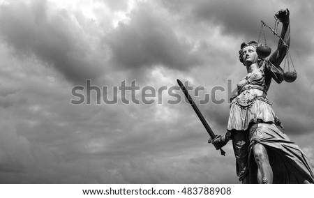 Statue of justice goddess (Justitia) with cloudy sky, Black and white