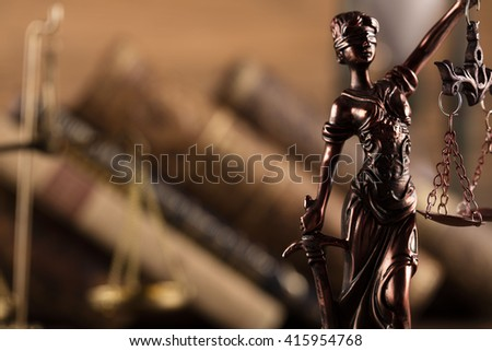 Statue of justice, scales of justice,books, law theme - stock photo