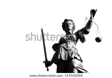 Statue of justice with sword and scale in black and white - stock photo