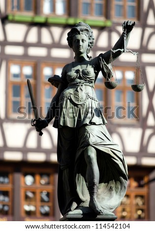 Statue of Justice with sword and scales in Frankfurt - stock photo