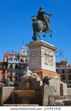 Statue of King at park in front of Royal Palace - Madrid Spain