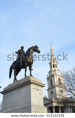 Statue of King George IV in Trafalgar Square with Saint Martin in the Fields church in the background. - stock photo
