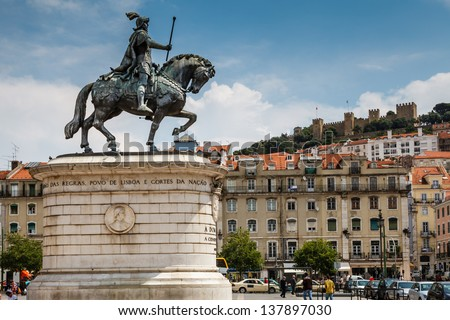 Statue of King Joao I at Figueiroa Square and St. Jorge Castle in Lisbon, Portugal