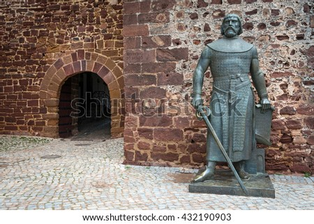 Statue of King Sancho I at the entrance into medieval castle of Silves, Algarve Portugal