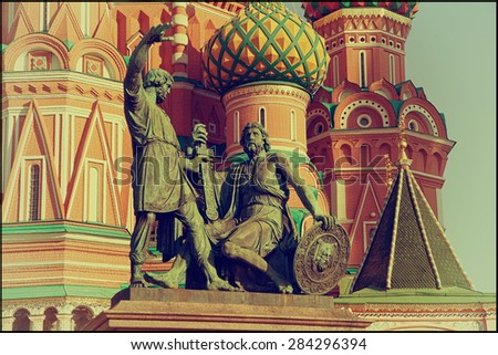 Statue of Kuzma Minin and Dmitry Pozharsky in front of St. Basil Cathedral in Moscow, Russia. Photo in vintage style - stock photo
