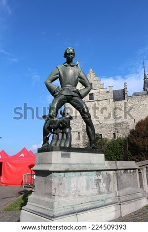 Statue of  Lange Wapper front of Het Steen, Antwerp, Belgium