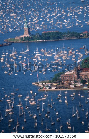 Statue of Liberty, Aerial View & Sailing Ships in Harbor, New York, New York - stock photo
