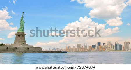 Statue of Liberty and the Manhattan skyline - stock photo