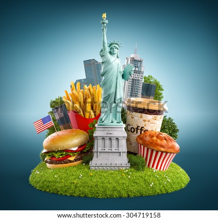 Statue of liberty and traditional american food on a grass meadow - stock photo