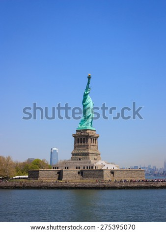 Statue of Liberty as seen from the ferry, side view. - stock photo