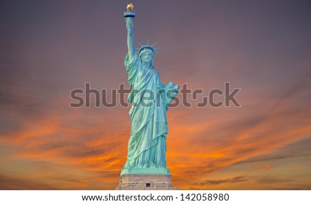 Statue of liberty at sunrise - stock photo