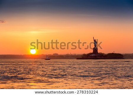 Statue of Liberty at sunset as viewed from Brooklyn, New York - stock photo
