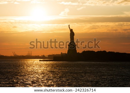 Statue of Liberty at sunset, New York City, USA. - stock photo