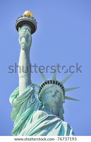 Statue of Liberty closeup with blue sky in New York City Manhattan - stock photo