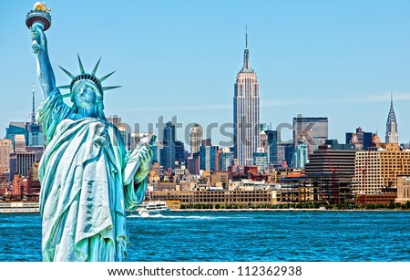 Statue of Liberty cut out over New York skyline background - stock photo