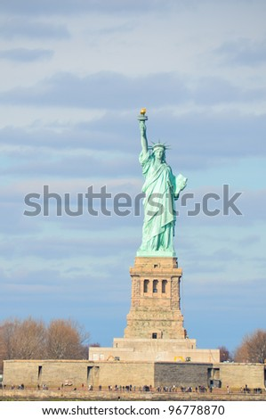 Statue of Liberty in a cloudy day, New York City - United States - stock photo