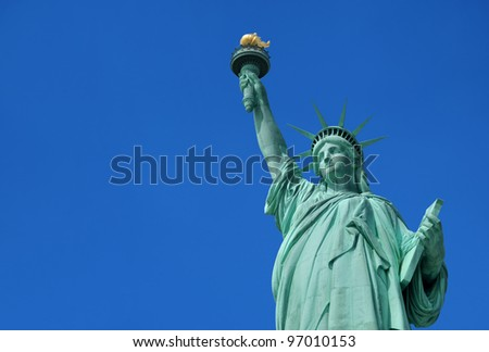 Statue of Liberty in New York City on a clear sunny day. - stock photo