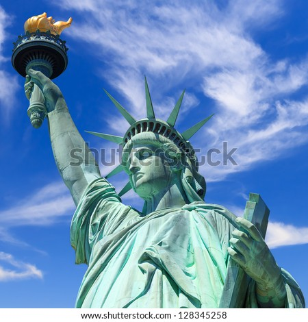statue of liberty, new york, usa, blue sky with clouds - stock photo