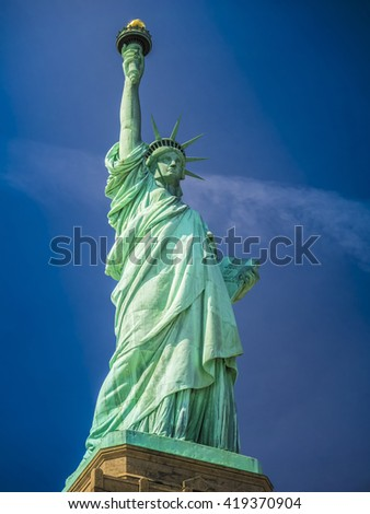 Statue of Liberty on a sunny day - stock photo