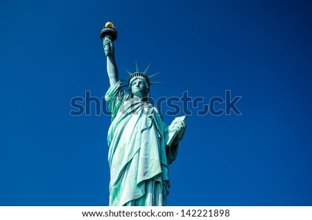 Statue of Liberty on blue clear sky, New York City, USA - stock photo
