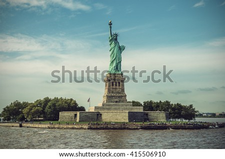 Statue of Liberty on Liberty Island on a sunny day, New York City, USA, vintage filtered style  - stock photo
