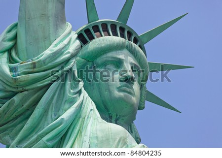 Statue of Liberty one of the most recognizable landmark of New York City and one of the symbols of United States of America - stock photo