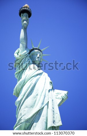 Statue of Liberty with blue sky - stock photo