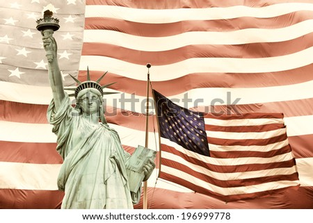 Statue of Liberty with two American flags. Large American flag in the background.Processed in subdued tones of color. - stock photo
