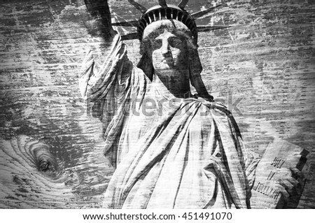 Statue of Liberty, wooden textured background in black and white - stock photo