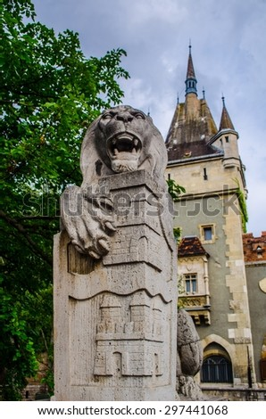 Statue of lion protecting entrance into vajdahunyad castle in budapest. - stock photo