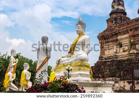 Statue of Lord Buddha preaching his disciples at Wat Yai Chaimongkon in Ayuthaya, Thailand. - stock photo
