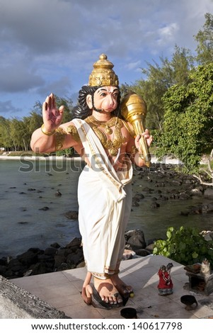 Statue of Lord Hanuman, Indian Hindu god in outdoor temple on beach of Mont Choisy, Mauritius island