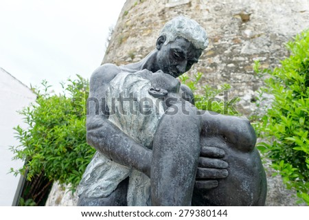 Statue of man holding woman - stock photo
