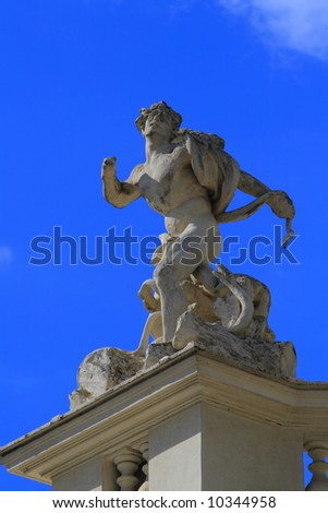 Statue of man with snake in Rome Italy, Villa Borghese