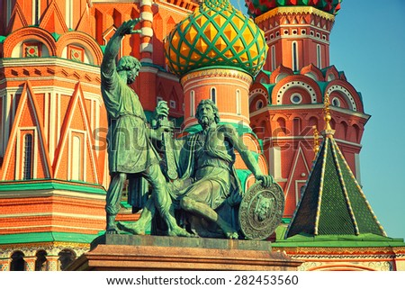 Statue of Minin and Pozharsky on the background of St. Basil's Cathedral in Moscow on Red Square - stock photo