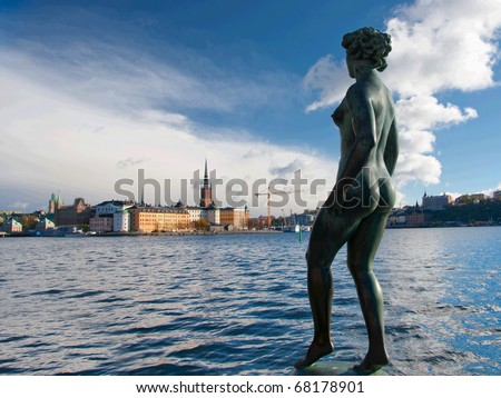 Statue of naked woman  in Stockholm near the water