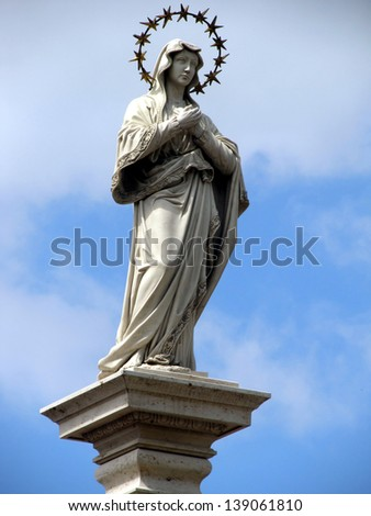Statue of Our Lady of the Immaculate Conception in the middle of the square in front of the monastery at Jasna Gora Monastery - Czestochowa (sculpture Kamila Drapikowski) - stock photo